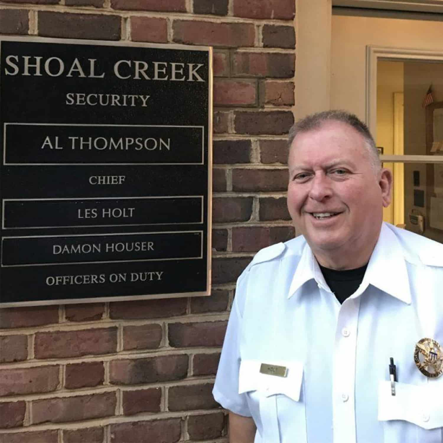 Shoal Creek Security Officer with on duty sign
